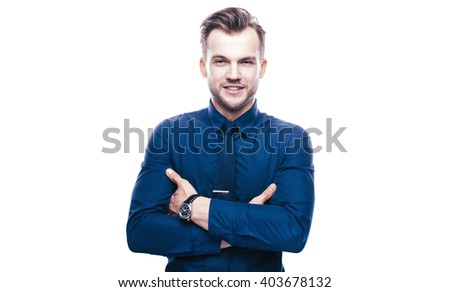 Handsome stylish young man in shirt looking at the camera. Office worker. Business decisions. Beautiful light background. Isolated - stock photo
