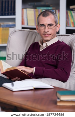 Handsome successful lawyer reading a book