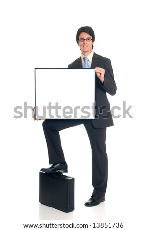 Handsome successful young sales manager with advertising board on briefcase, joyful expression, studio shot.