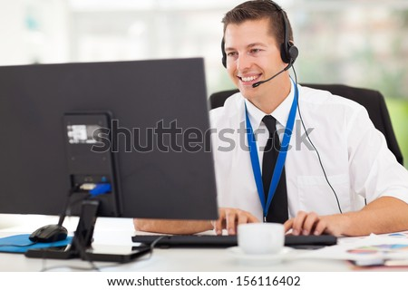 handsome technical support operator working on computer - stock photo