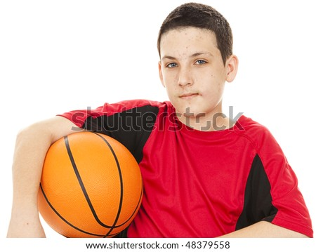 Handsome teenage boy suffers from acne.  White background. - stock photo