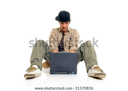 Handsome teenager boy student with laptop, casual dressed,  Studio shot, white background - stock photo