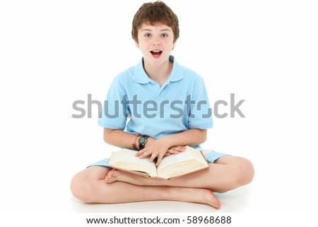 Handsome ten year old american boy with book over white background.