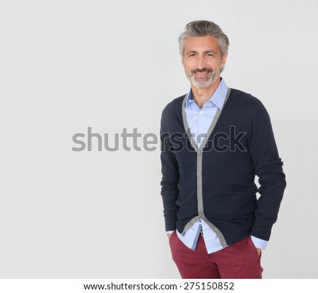 Handsome trendy mature man on grey background - stock photo
