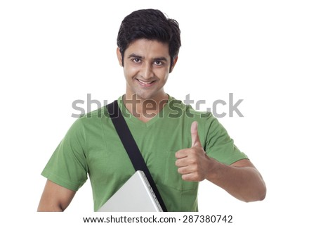 Handsome university student giving thumbs up over white background - stock photo