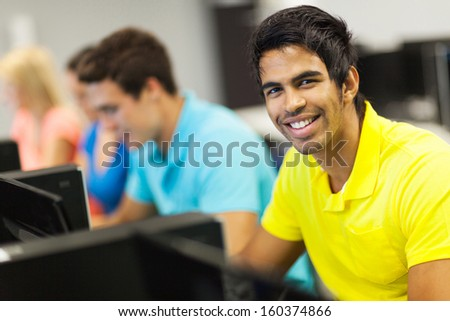 handsome university student in computer room - stock photo