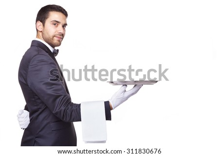 Handsome waiter holding an empty silver tray, isolated on white background - stock photo