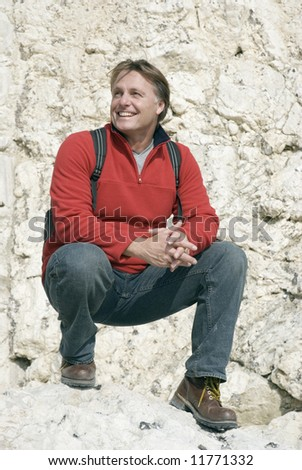 Handsome 43 year old man on rocks. - stock photo