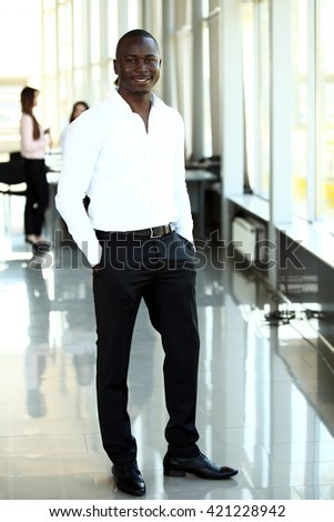 handsome young african american businessman in office - stock photo