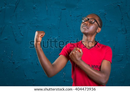 Handsome young african american man, showing off his physique in an aggressive pose - stock photo