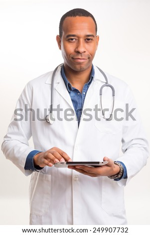 Handsome young african doctor posing isolated over a white background - stock photo