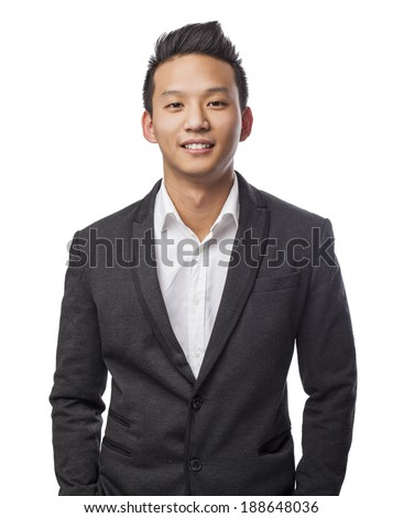 handsome young asian man standing wearing a suit - stock photo