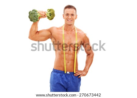 Handsome young athlete posing shirtless with a broccoli dumbbell in his hand and a measuring tape around his neck isolated on white background - stock photo