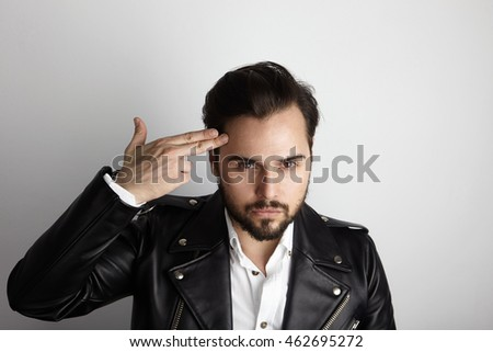 Handsome Young Bearded Man Wearing Stylish Shirt Black Leather Jacket Shot Hand Head.Beauty,Lifestyle,People Concept Photo.Adult Serious Hipster Guy Empty White Background.Horizontal