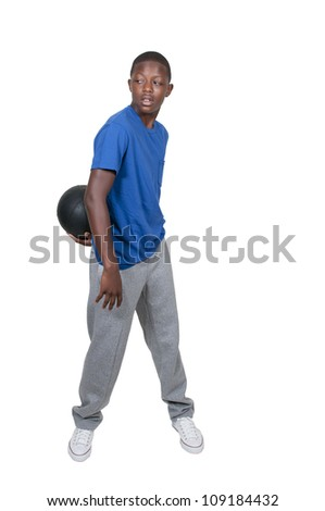 Handsome young black African American teenage man playing basketball - stock photo