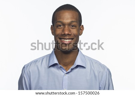 Handsome young black man smiling, horizontal - stock photo