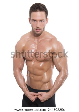 handsome young bodybuilder flexing his muscles on isolated background - stock photo