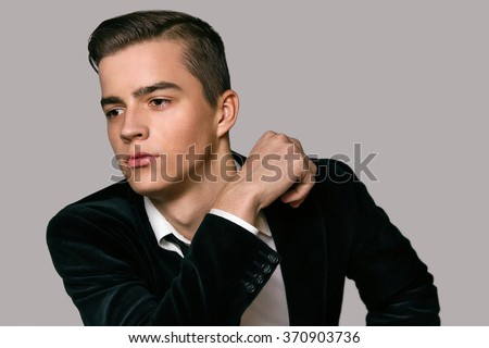 handsome young boy in a business suit Portrait Studio - stock photo