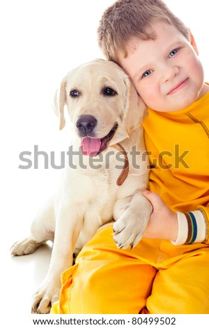 Handsome Young Boy Playing with His Dog Against White Background - stock photo