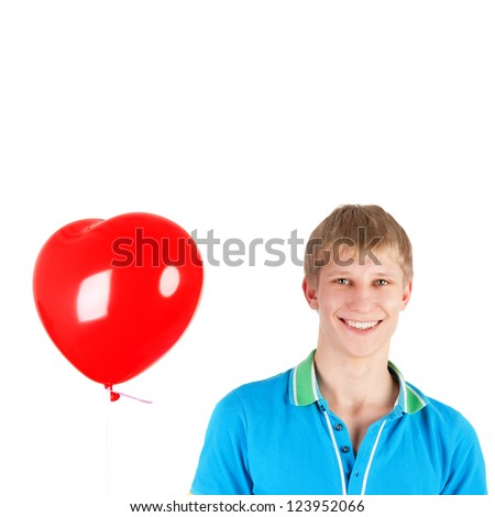 handsome young boy with the heart shape balloon - stock photo