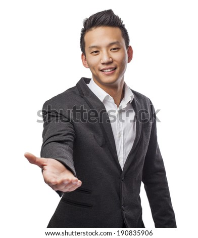 Handsome young business asian man offering help - stock photo