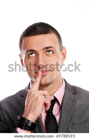 Handsome young business dreamy man isolated against white - stock photo