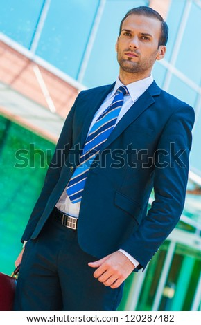 handsome young business man at office building