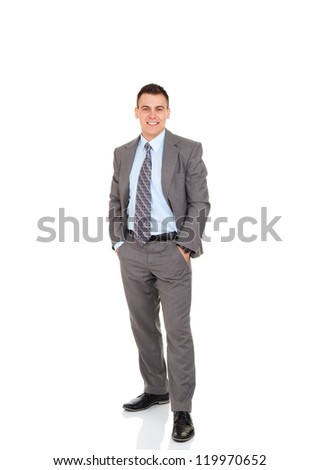 Handsome young business man happy smile, businessman with hands in pockets wear elegant gray suit and tie full length portrait isolated over white background - stock photo