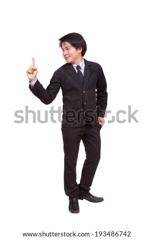 Handsome young business man happy smile point finger to empty copy space