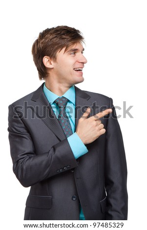 Handsome young business man happy smile point finger to empty copy space, businessman showing pointing side, concept of advertisement product, isolated over white background - stock photo