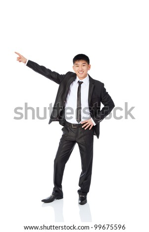 Handsome young business man happy smile point finger to empty copy space, businessman showing pointing side, concept of advertisement product, wear elegant suit and tie isolated over white background