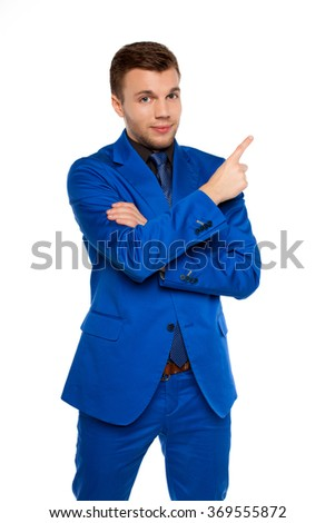 Handsome young business man happy smiley pointing finger up to empty copy space, while holding a briefcase - stock photo