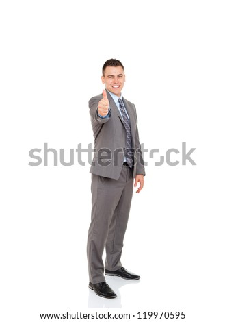 Handsome young business man hold hand with thumb up gesture, businessman excited happy smile, wear elegant gray suit, full length portrait isolated over white background