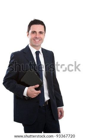 Handsome young business man in blue suit holding laptop. Isolated on white. - stock photo