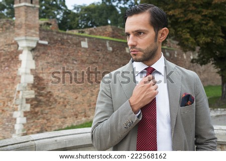 Handsome young  business man in the park after work - stock photo