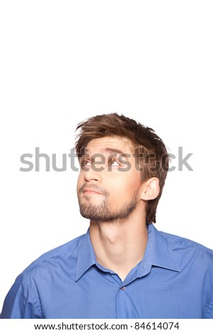 Handsome young business man looking up, isolated over white background. series of portrait photos.