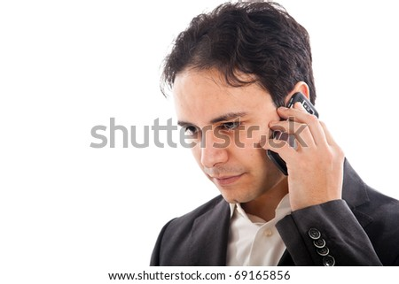 Handsome young business man on phone. Isolated on white