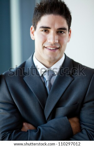 handsome young businessman closeup portrait - stock photo