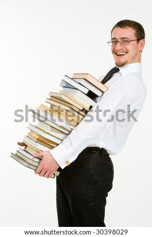 Handsome young businessman holding stack of books, isolated