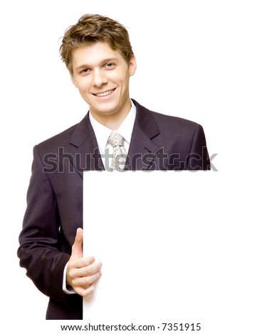 Handsome young businessman holds a blank cardboard