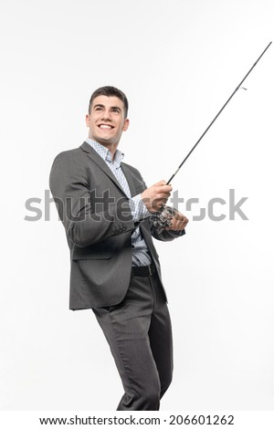 Handsome young businessman in good suit dreaming about his future catch. Concept of comparison fishing and business. Isolated on white background