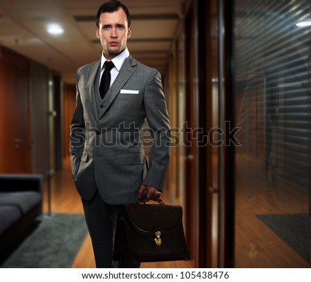 Handsome young businessman in office - stock photo