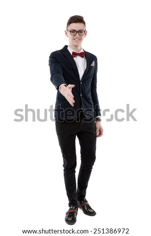 Handsome young businessman stretches out his hand to introduce himself - stock photo