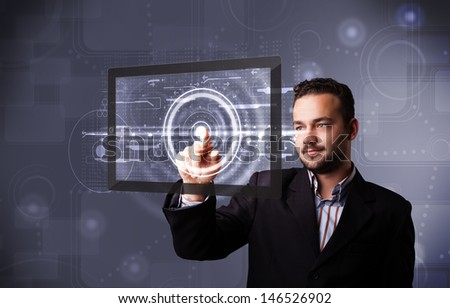 Handsome young businessman touching modern technology tablet - stock photo