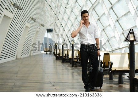 handsome young businessman walking in a public transportation station - stock photo