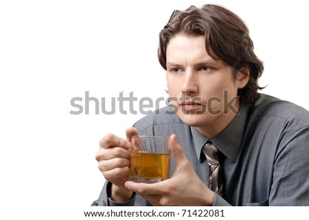 Handsome young businessman with a cup of green tea against white background