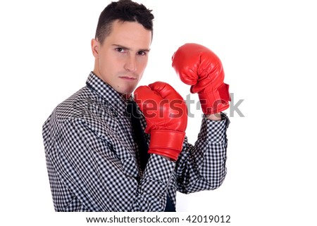 Handsome young businessman with boxing gloves.  Studio white background