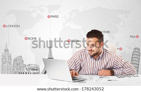 Handsome young businessman with world map and major landmarks of the world - stock photo