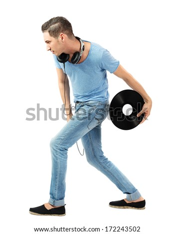 Handsome young caucasian male throwing vinyl disc on isolated white background. - stock photo
