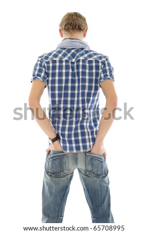 Handsome young caucasian man from back. Hands in pockets. Studio shot. White background. - stock photo